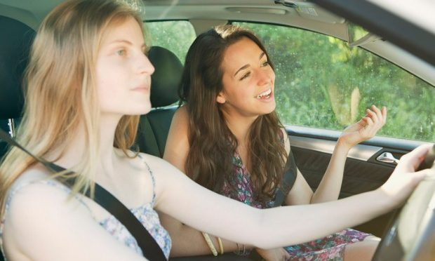 Don't get distracted when driving with passengers_istock